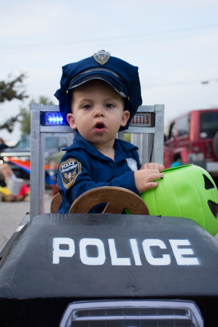 Jace Williams, 2 of Guthrie, looks out from his homemade police car at Waterloo Road Baptist Church's Fall Frolic.