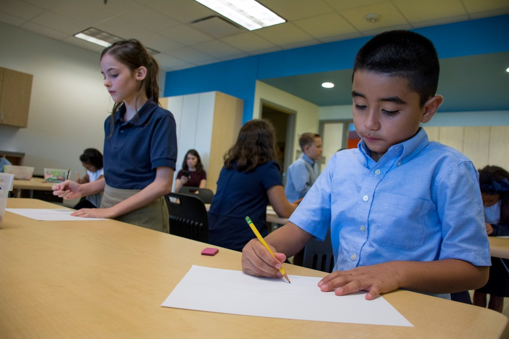 Salvador Trejo, a fourth-grader draws during his second day class at John Rex Elementary