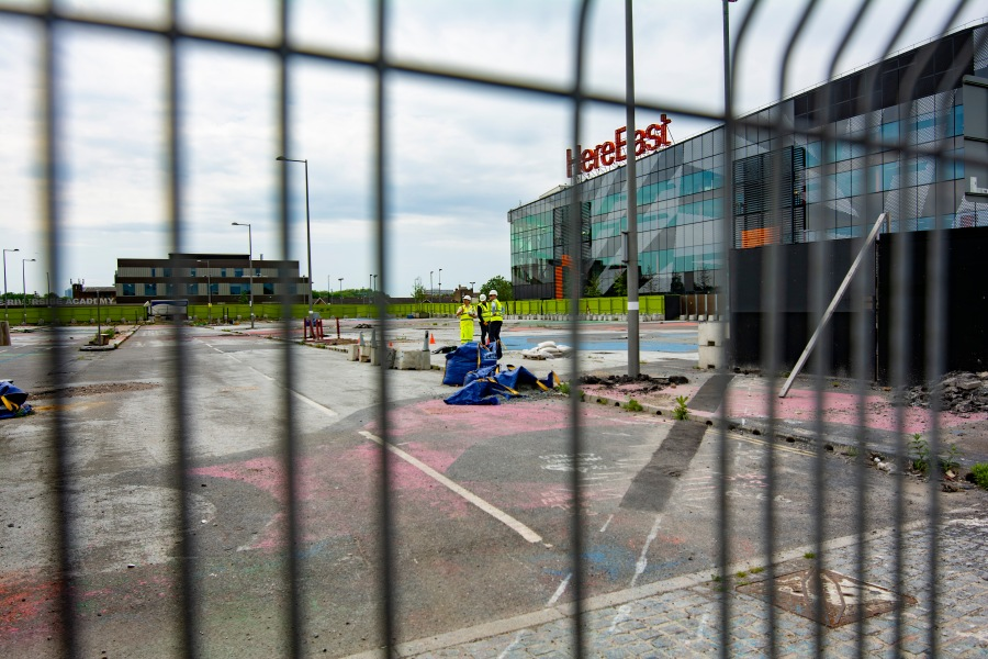 HereEast general contractor and workers stand at the sight of a new development..jpg