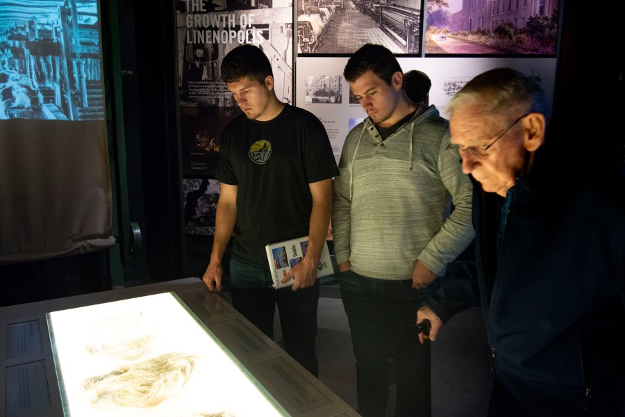 Josh Morgan, left, and Josh Griffin look at an exhibit in the Titanic Museum