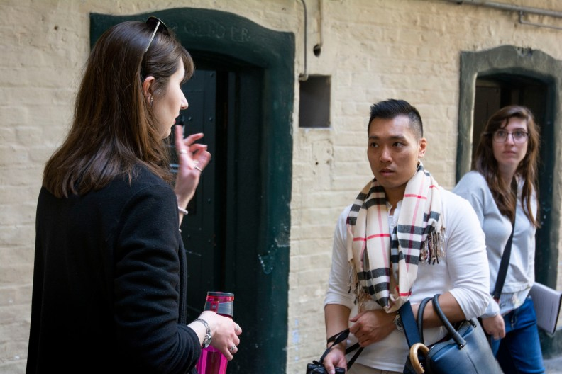 Shauna Fox, a tour guide at Kilmainham Gaol prison, talks with Anthony Nguyen about the prison cells